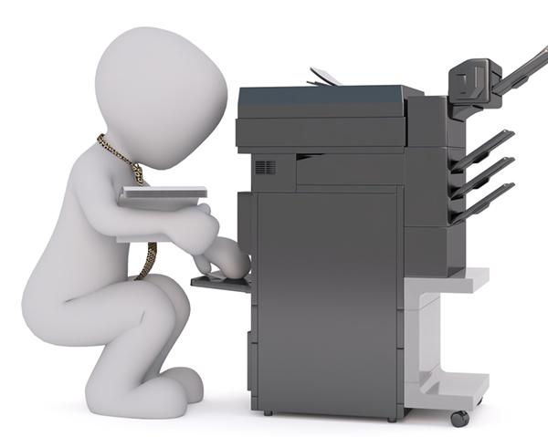 white male operating printer