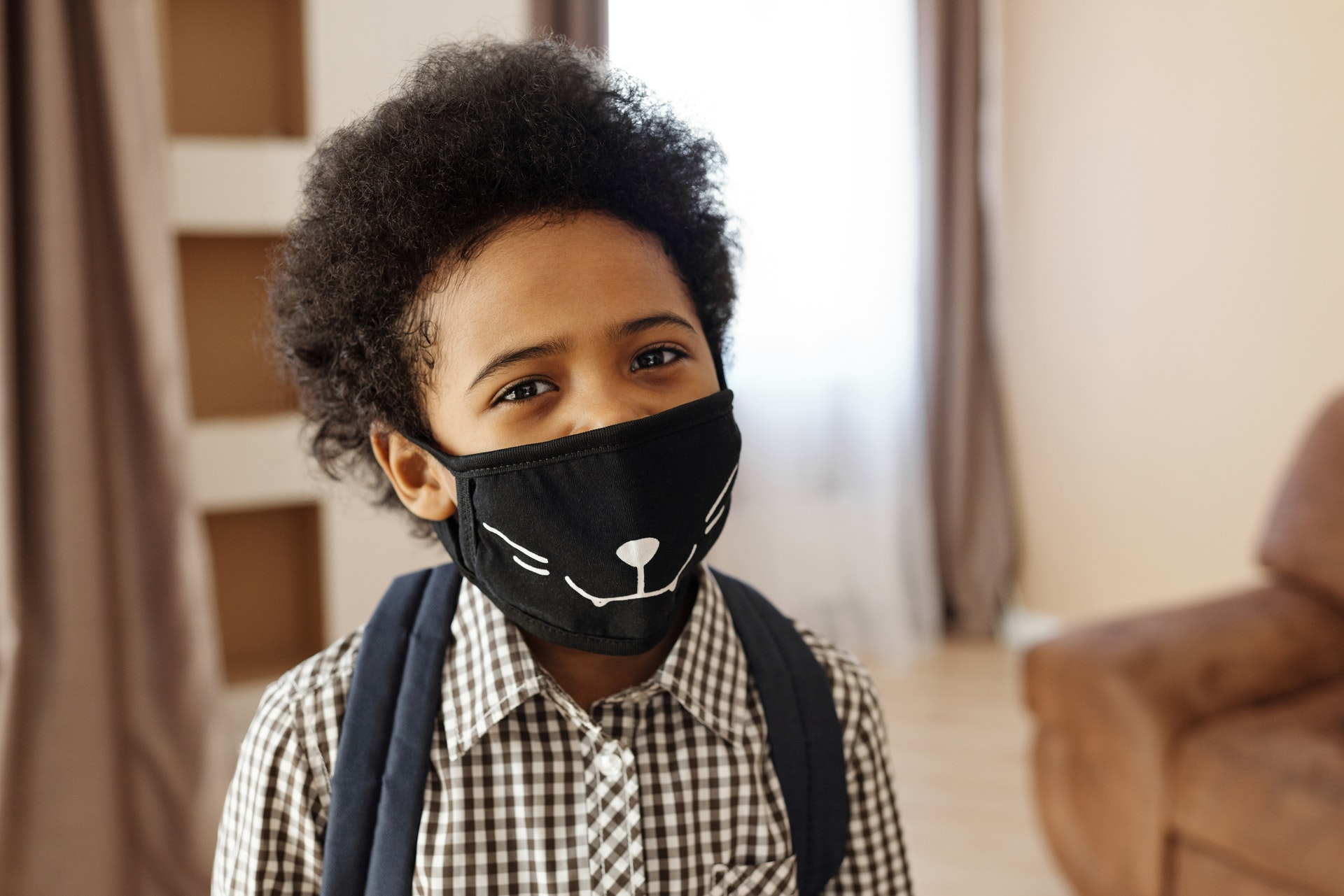 boy with custom face mask featuring cat's whiskers